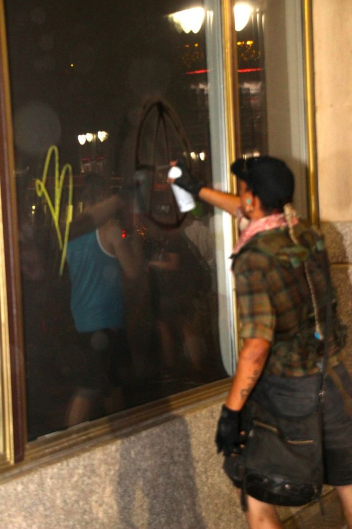 Tagger Defacing Property During Protests