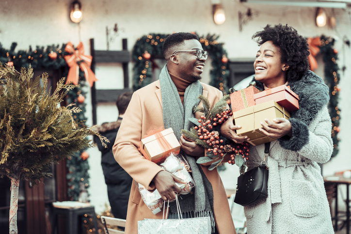 Young couple at Christmas shopping, holding Christmas present's